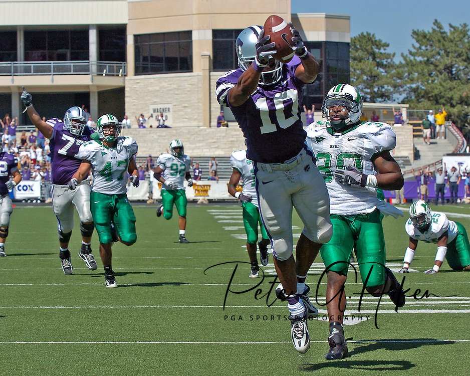 Kansas State wide receiver Jermaine Moreira (10) dives into the end zone past Marshall's Dennis Thornton (30) for a 44-yard touchdown in the fourth quarter, at Bill Snyder Family Stadium in Manhattan, Kansas, September 16, 2006.  The Wildcats beat the Thundering Herd 23-7.