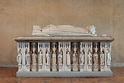 Plaster copy of the tomb of the Duke of Berry, 1340-1416, brother of King Charles V, with his effigy and bear sleeping at his feet, the original being in the crypt of Bourges Cathedral, or the Cathedrale Saint-Etienne de Bourges, by Paul Gauchery, early 20th century, in the Salle d'Apparat or Ceremonial Hall of the Palais Jacques Coeur, huge manor house built 1443-51 in Flamboyant Gothic style, on the Place Jacques Coeur, Bourges, France. Jacques Coeur, 1395-1456, was a wealthy merchant and was made master of the mint to King Charles VII in 1438. The building is listed as a historic monument. Picture by Manuel Cohen