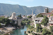 Stari Most or Old Bridge, a 16th century Ottoman bridge across the Neretva river in Mostar, Bosnia and Herzegovina. The bridge was destroyed in the 1990s Yugoslavian war and has been rebuilt. The town is named after the mostari or bridge keepers of the Old Bridge. Mostar developed in the 15th and 16th centuries as an Ottoman frontier town and is listed as a UNESCO World Heritage Site. Picture by Manuel Cohen