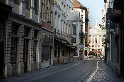 "© Licensed to London News Pictures. 23/11/2015. Brussels, Belgium. A deserted street at 2pm in central Brussels where the city is currently on ""lockdown"" amid ""imminent threat"" of Paris-style bomb and gun attacks. Photo credit: Ben Cawthra/LNP"
