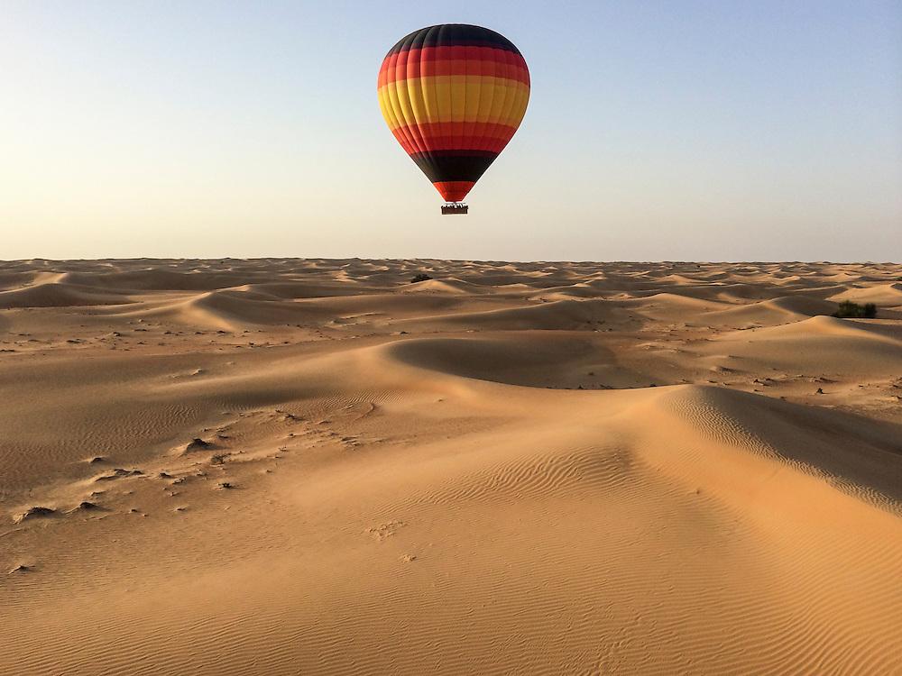 DUBAI, UAE — FEBRUARY 2, 2014: Hot air balloon above the desert in Dubai **IPHONE**