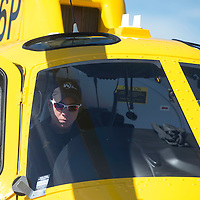 Virginia Williams, retired pilot for the Army exits the medical helicopter at Cibola General Hospital after flying it over from the Grants airport Friday.