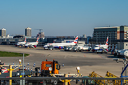 © Licensed to London News Pictures. 26/03/2020. London, UK. British Airways planes at their stands at London City Airport. London City Airport announced it would close on the evening of Wednesday 25th March 2020 and remain shut until the end of April due to the coronavirus outbreak. All commercial and private flights will be temporarily suspended. London City is the UK's twelfth busiest airport. Photo credit: Peter Manning/LNP