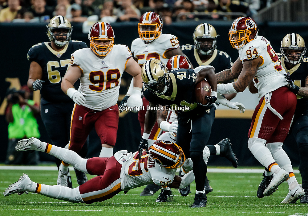 Nov 19, 2017; New Orleans, LA, USA; New Orleans Saints running back Alvin Kamara (41) is tackled by Washington Redskins safety Montae Nicholson (35) during the first quarter of a game at the Mercedes-Benz Superdome. Mandatory Credit: Derick E. Hingle-USA TODAY Sports
