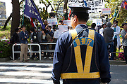 A policeman keeps watch at a Zengakuren student union demo at Hosei University Campus. Ichigaya, Tokyo, Japan. Friday April 25th 2014