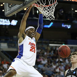 Mar 26, 2011; New Orleans, LA; Florida Gators forward Alex Tyus (23) dunks over Butler Bulldogs forward Matt Howard (54) during the second half of the semifinals of the southeast regional of the 2011 NCAA men's basketball tournament at New Orleans Arena.   Mandatory Credit: Derick E. Hingle