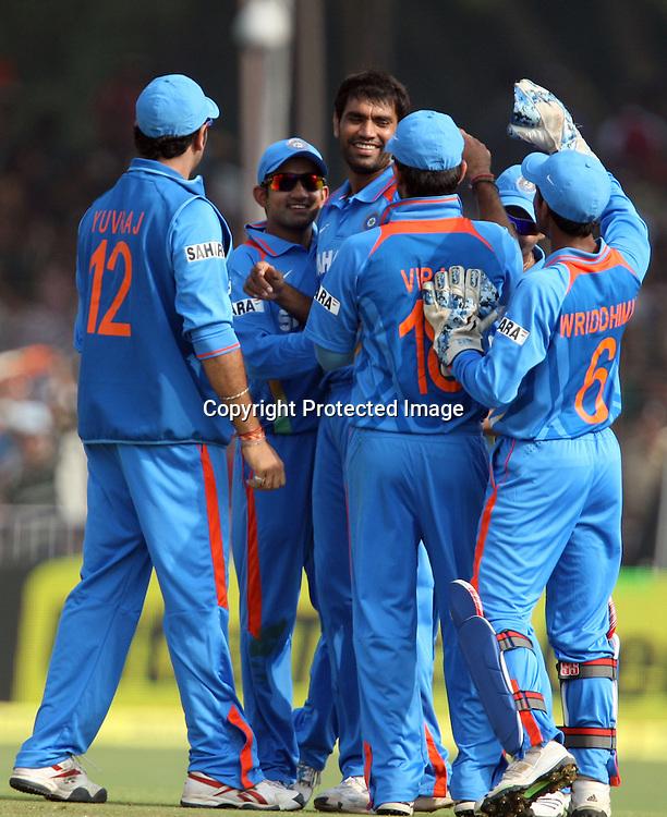 Indian bowler Munaf Patel celebrates with team mates New Zealand Batsman Kane Williamson during the 3rd ODI India vs New Zealand Played at Reliance Stadium, Vadodara, 4 December 2010 (50-over match)