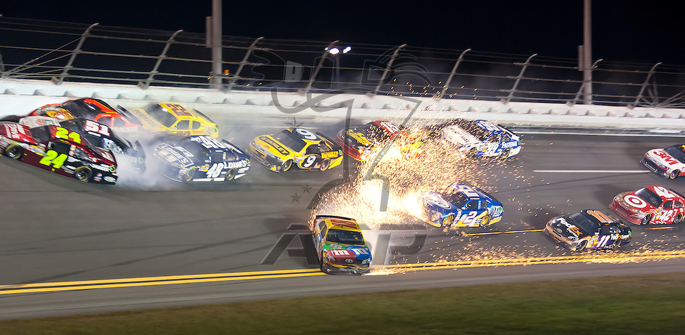 Daytona Beach, FL - Feb 18, 2012:  Kyle Busch (18) spins off turn 4 but holds on to win the Budweiser Shootout at the Daytona International Speedway in Daytona Beach, FL.