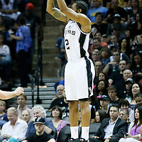 03 April 2015: San Antonio Spurs forward Kawhi Leonard (2) takes a jump shot during the San Antonio Spurs 123-93 victory over the Denver Nuggets , at the AT&T Center, San Antonio, Texas, USA.