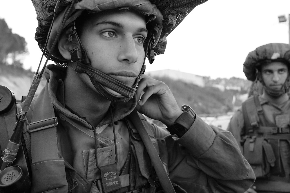 Avishay Pelach, a 19 year old paratrooper straight out of training, guarding a base on the northern border with Lebanon. Aug 2006