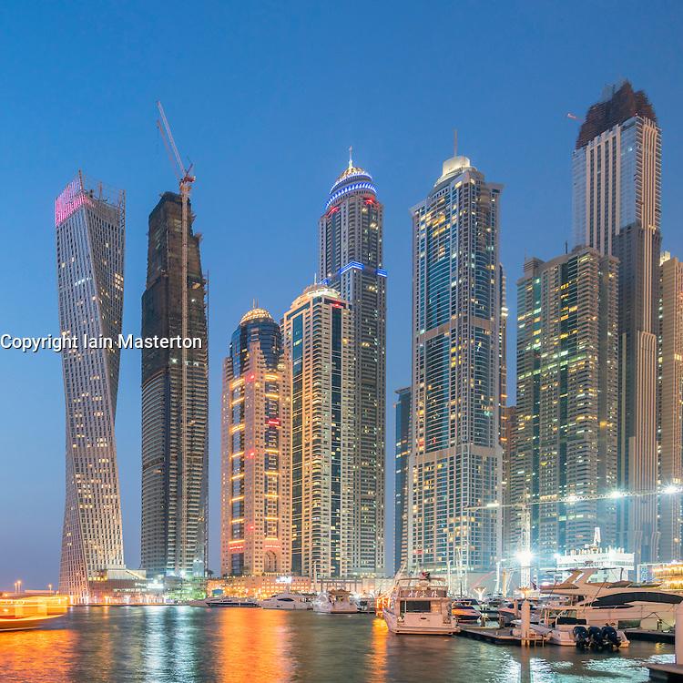Skyline of skyscrapers  at night in  Marina district of Dubai United Arab Emirates