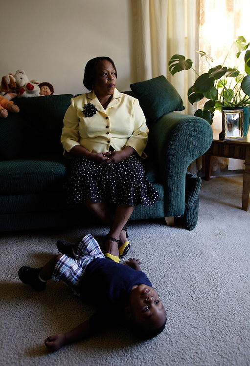 INGLEWOOD, CA, OCTOBER 22, 2006:     Angel Brown is the mother of hate crime murder victim Christopher Brown. She moved away from Highland Park after her son was murdered. She now lives in predominantly black Inglewood, CA in a small apartment where she spends time with her grandson, Nazir. Photograph by Todd Bigelow/Aurora)...