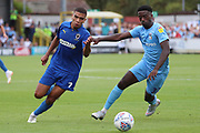 AFC Wimbledon defender Tennai Watson (2) dribbling and taking on Coventry City attacker Jordy Hiwula Mayifuila (11) during the EFL Sky Bet League 1 match between AFC Wimbledon and Coventry City at the Cherry Red Records Stadium, Kingston, England on 11 August 2018.