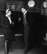 Man and woman talk at Crooked Billett  pub 1940s