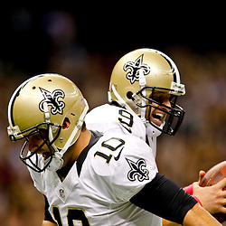 October 7, 2012; New Orleans, LA, USA; New Orleans Saints quarterback Drew Brees (9) celebrates with quarterback Chase Daniel (10) after throwing a touchdown pass to wide receiver Devery Henderson (not pictured) to break the NFL record for consecutive games throwing a touchdown at 48 games eclipsing a record once held by Johnny Unitas during the first quarter of a game against the San Diego Chargers at the Mercedes-Benz Superdome. Mandatory Credit: Derick E. Hingle-US PRESSWIRE