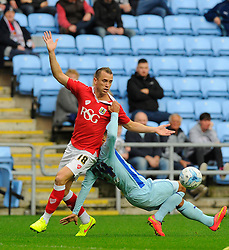 Bristol City's Aaron Wilbraham battles for the ball with Coventry City's Jordan Clarke  - Photo mandatory by-line: Joe Meredith/JMP - Mobile: 07966 386802 - 18/10/2014 - SPORT - Football - Coventry - Ricoh Arena - Bristol City v Coventry City - Sky Bet League One