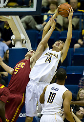 January 9, 2010; Berkeley, CA, USA;  California Golden Bears center Max Zhang (14) grabs a rebound from Southern California Trojans forward Nikola Vucevic (5) during the first half at the Haas Pavilion.  California defeated USC 67-59.