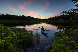 Kayaking a small pond in Barrington, New Hampshire. Sunset.