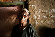 Marangu - An elder inside a hole-in-the-wall bar in a rural community where banana wine and beer are fermented and sold.