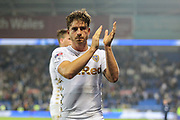 Gaetano Berardi of Leeds United applauds the away support after the EFL Sky Bet Championship match between Cardiff City and Leeds United at the Cardiff City Stadium, Cardiff, Wales on 26 September 2017. Photo by Andrew Lewis.