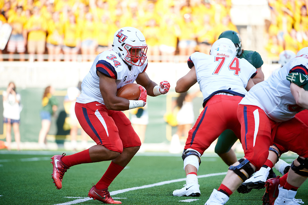 WACO, TX - SEPTEMBER 2:  Carrington Mosley #34 of the Liberty Flames breaks free against the Baylor Bears during a football game at McLane Stadium on September 2, 2017 in Waco, Texas.  (Photo by Cooper Neill/Getty Images) *** Local Caption *** Carrington Mosley
