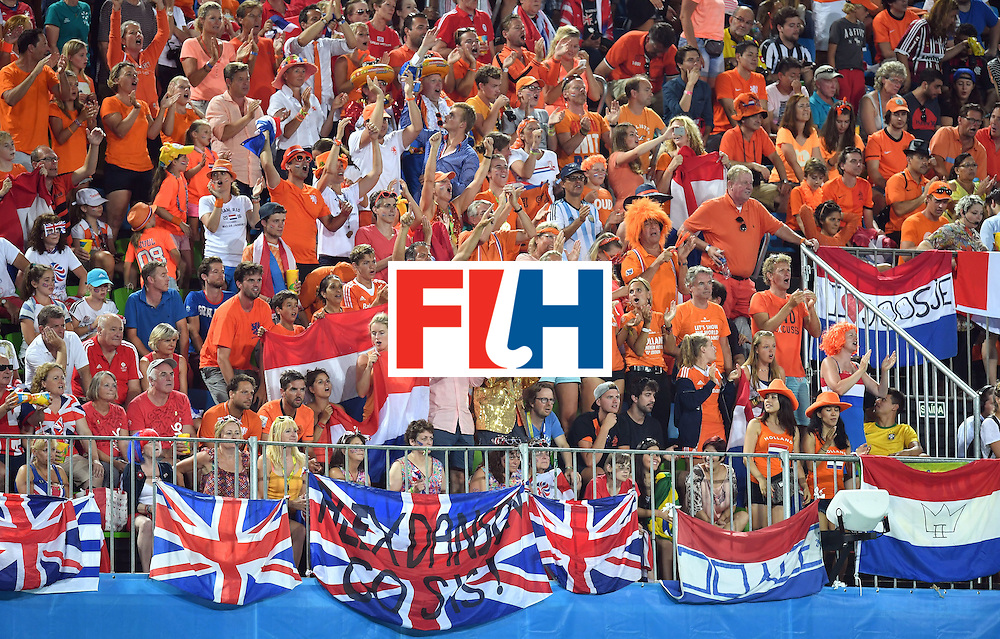 Netherlands fans cheer their team during the women's Gold medal hockey Netherlands vs Britain match of the Rio 2016 Olympics Games at the Olympic Hockey Centre in Rio de Janeiro on August 19, 2016. / AFP / MANAN VATSYAYANA        (Photo credit should read MANAN VATSYAYANA/AFP/Getty Images)