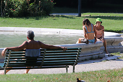 Italy, Milan -  July 31, 2018.Italy's summer heat wave..People refresh themself in a public fountain (Credit Image: © Fotogramma/Ropi via ZUMA Press)