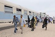 Passengers boarding the Iron ore train of zouerat, the longest and heaviest train in the world, Nouadhibou, Western Africa, Mauretania, Africa