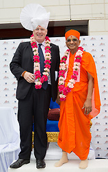 Boris Johnson to visit the Hindu Temple. The Mayor of London Boris Johnson wearing a' Pagh' type of Turban  stands with Hindu spiritual leader Acharya Swamishree while in a visit to the Shree Swaminarayan Mandir, a major new Hindu temple being built in Kingsbury. Shree Swaminarayan Mandir, London, United Kingdom. Wednesday, 28th May 2014. Picture by Daniel Leal-Olivas / i-Images
