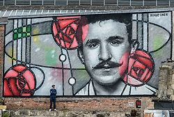 Pictured: Artist Bob McNamara aka Rogue One with the mural.<br /> <br /> A giant street mural, inspired by the work of Charles Rennie Mackintosh, by Art Pistols Projects and artist Rogue-One has been unveiled in Glasgow City Centre. <br /> &copy; Dave Johnston / EEm