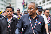 26 NOVEMBER 2013 - BANGKOK, THAILAND: Former Deputy Prime Minister SUTHEP THAUGSUBAN, leader of the anti-government protests rocking Bangkok, walks through the Ministry of Finance complex. The Thai government issued as warrant for Suthep as the protests spread but he has not been arrested. Protestors opposed to the government of Thai Prime Minister Yingluck Shinawatra spread out through Bangkok this week. Protestors have taken over the Ministry of Finance, Ministry of Sports and Tourism, Ministry of the Interior and other smaller ministries. The protestors are demanding the Prime Minister resign, the Prime Minister said she will not step down. This is the worst political turmoil in Thailand since 2010 when 90 civilians were killed in an army crackdown against Red Shirt protestors. The Pheu Thai party, supported by the Red Shirts, won the 2011 election and now govern. The protestors demanding the Prime Minister step down are related to the Yellow Shirt protestors that closed airports in Thailand in 2008.     PHOTO BY JACK KURTZ