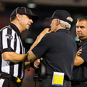21 September 2019: San Diego State Aztecs head coach Rocky Long talks with an official after a defensive pass interference call against the Aztecs was overturned in the fourth quarter. The Aztecs lost to the Aggies 23-17 Saturday night at SDCCU Stadium.<br /> (Credit: Derrick Tuskan/San Diego State)<br /> More game action at sdsuaztecphotos.com