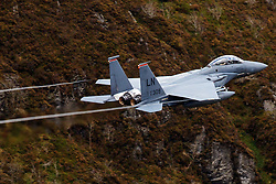 United States Air Force McDonnell-Douglas F-15E Strike Eagle (LN 91-309) from the 48th Fighter Wing, 494th Fighter Squadron based at RAF Lakenheath, England, flies low level through the Mach Loop, Machynlleth, Wales, United Kingdom