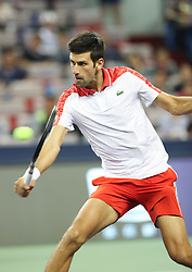 October 9, 2018 - Shanghai, China - Serbia's NOVAK DJOKOVIC hits a return during the men's singles second round match against France's Jeremy Chardy at the Shanghai Masters tennis tournament. Novak Djokovic won 2-0. (Credit Image: © Ding Ting/Xinhua via ZUMA Wire)