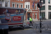 A TFL Santander bike engineer and a scene of bikes, on 11th January 2017, in Mayfair, London, England.