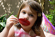 Anna Sanders plays with a leaf in the hammock; New Orleans, Louisiana