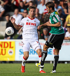06.07.2013, Dr. Franz Hofmaninger Stadion, Bad Wimsbach, AUT, Testspiel, 1. FC Koeln vs SV Josko Ried, im Bild Maxi Thiel, (1. FC Koeln, #15) und Jan Marc Riegler, (SV Josko Ried, #14) //during Friendly Match between 1. FC Koeln and SV Josko Ried at the Dr. Franz Hofmaninger Stadion, Bad Wimsbach, Austria on 20130706. EXPA Pictures © 2013, PhotoCredit: EXPA/ Roland Hackl