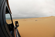 Exploring Namib Desert sand dune;