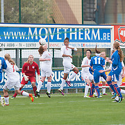 21120413 - IEPER, BELGIUM : players gather inf front of England's  Jessica Myers (1)  goal during the Second qualifying round of U17 Women Championship between England and Iceland on Friday April 13th, 2012 in Ieper, Belgium.