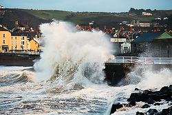 © Licensed to London News Pictures. 07/12/2018. Aberystwyth, UK. Strong gale force winds and a high tide combine to hammer huge waves against the sea defences in Aberystwyth on the Cardigan Bay coast of west Wales. A yellow Met Office warning for heavy rain has been issued for much of south Wales, and another one for strong winds reaching 70 or 80mph in the north of the UK. Photo credit: Keith Morris/LNP