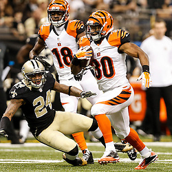 Nov 16, 2014; New Orleans, LA, USA; Cincinnati Bengals running back Cedric Peerman (30) runs past New Orleans Saints cornerback Corey White (24) during the first quarter of a game at the Mercedes-Benz Superdome. Mandatory Credit: Derick E. Hingle-USA TODAY Sports