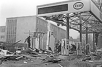Aftermath of a Provisional IRA bombing of Fortwilliam Esso Service Station, Belfast, N Ireland, 20th December 1969. 196912200265<br /> <br /> Copyright Image from Victor Patterson, 54 Dorchester Park, Belfast, UK, BT9 6RJ<br /> <br /> t1: +44 28 9066 1296<br /> t2: +44 28 9002 2446<br /> m: +44 7802 353836<br /> <br /> e1: victorpatterson@me.com<br /> e2: victorpatterson@gmail.com<br /> <br /> IMPORTANT: My Terms and Conditions of Business are at www.victorpatterson.com