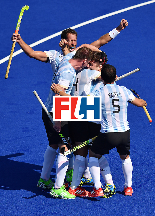 Argentina's players celebrate after scoring during the men's quarterfinal field hockey Spain vs Argentina match of the Rio 2016 Olympics Games at the Olympic Hockey Centre in Rio de Janeiro on August 14, 2016. / AFP / MANAN VATSYAYANA        (Photo credit should read MANAN VATSYAYANA/AFP/Getty Images)