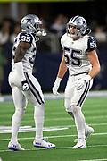 Dallas Cowboys rookie outside linebacker Leighton Vander Esch (55) celebrates with Dallas Cowboys free safety Kavon Frazier (35) after Vander Esch stuffs a third quarter run for a loss of a yard at the Cowboys 48 yard line during the NFL week 13 regular season football game against the New Orleans Saints on Thursday, Nov. 29, 2018 in Arlington, Tex. The Cowboys won the game 13-10. (©Paul Anthony Spinelli)