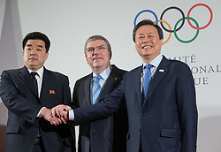 LAUSANNE, Jan. 20, 2018  International Olympic Committee (IOC) President Thomas Bach (C) shakes hands with Kim Il Guk (L), the president of the Olympic Committee of the Democratic People's Republic of Korea (DPRK) and Do Jong-hwan (R), minister of Culture, Sports and Tourism of South Korea in Lausanne, Switzerland, on Jan. 20, 2018. (Credit Image: © Xu Jinquan/Xinhua via ZUMA Wire)