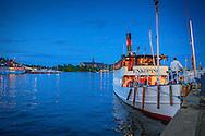 Fartyget Enköping ligger vid kajen vid Nybroviken i Stockholm. / The ship Enköping located at the quay in central Stockholm in Stockholm.