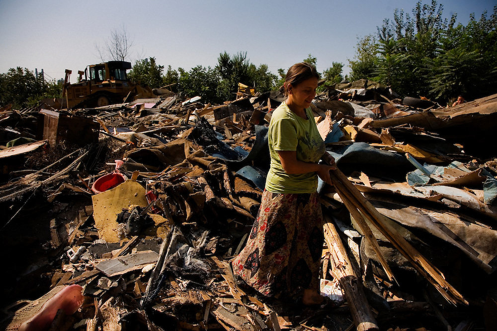 A woman combs through the remains of her house in Nova Gazela during the city of Belgrade's operation to remove the Gazela settlements.