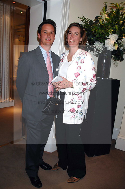 The DUKE & DUCHESS OF ARGYLL at the Sotheby's Summer Party 2007 at their showrooms in New Bond Street, London on 4th June 2007.<br />