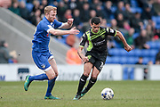 Jacob Mellis (Bury) runs with the ball under pressure from the Oldham Athletic defender during the EFL Sky Bet League 1 match between Oldham Athletic and Bury at Boundary Park, Oldham, England on 11 March 2017. Photo by Mark P Doherty.