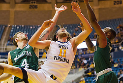 Nov 28, 2016; Morgantown, WV, USA; West Virginia Mountaineers forward Nathan Adrian (11) and Manhattan Jaspers forward Zane Waterman (4) fight for a loose ball during the first half at WVU Coliseum. Mandatory Credit: Ben Queen-USA TODAY Sports